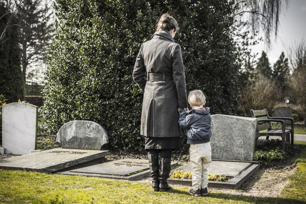woman with child at a graveyard