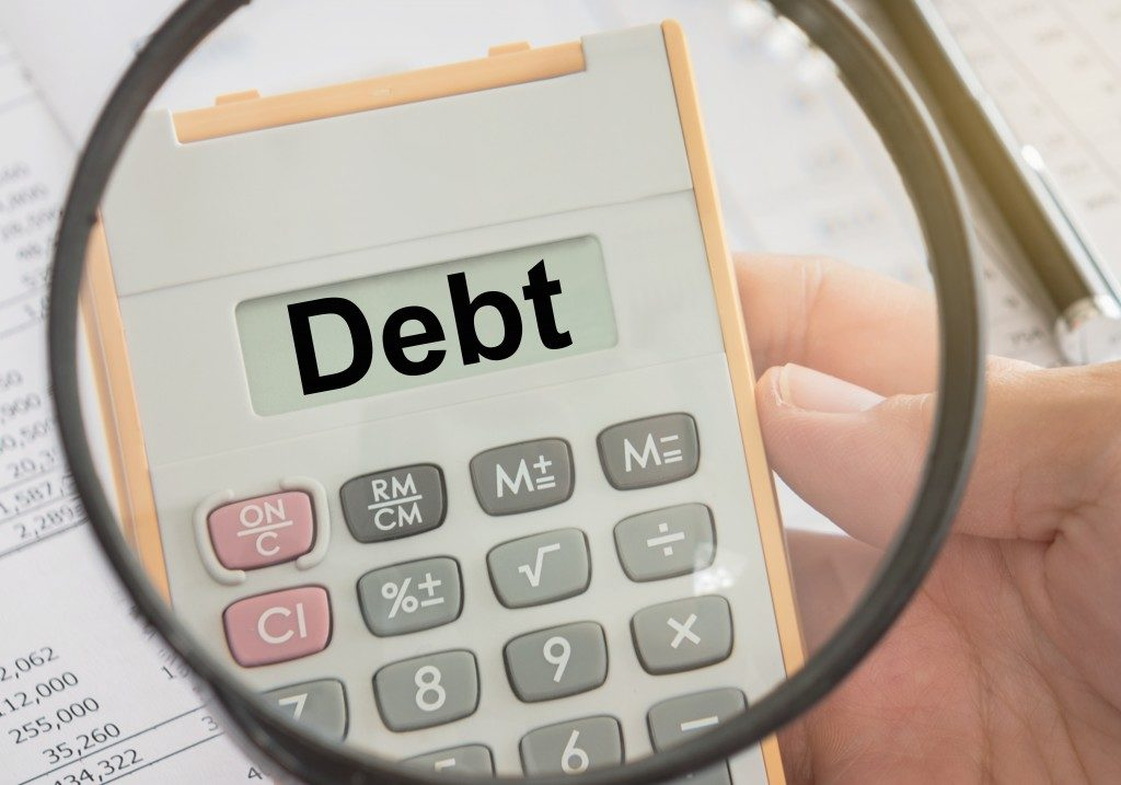 debt written on calculator