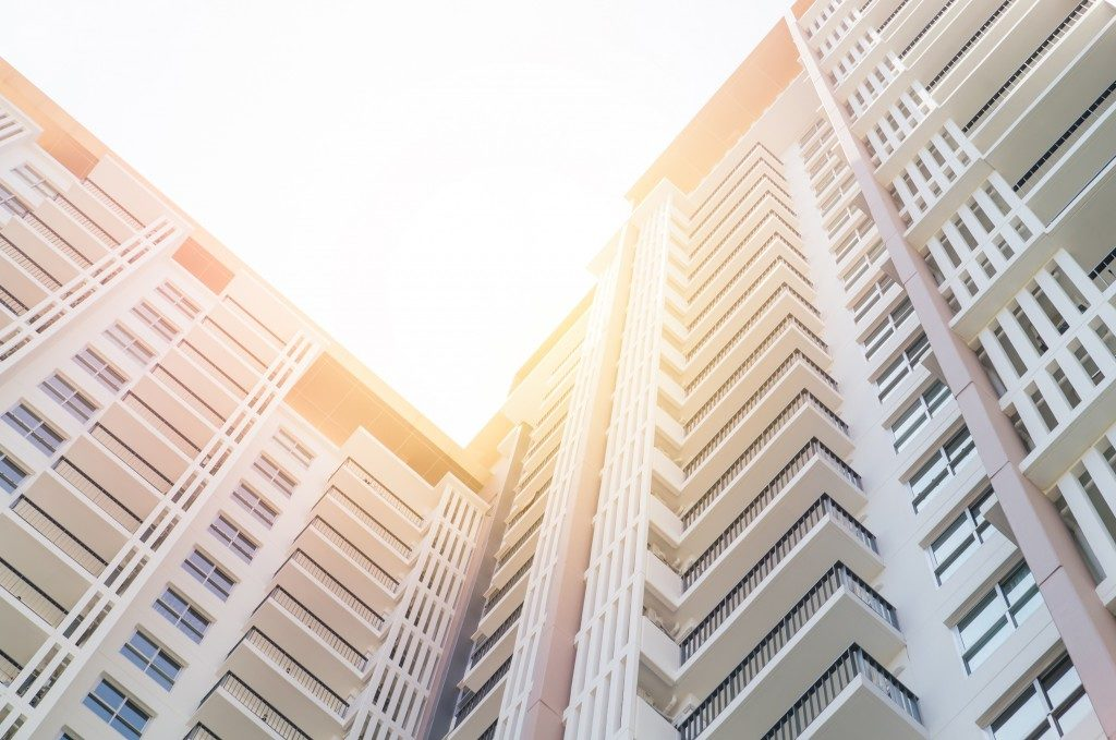 Condominium shot from below with the sun
