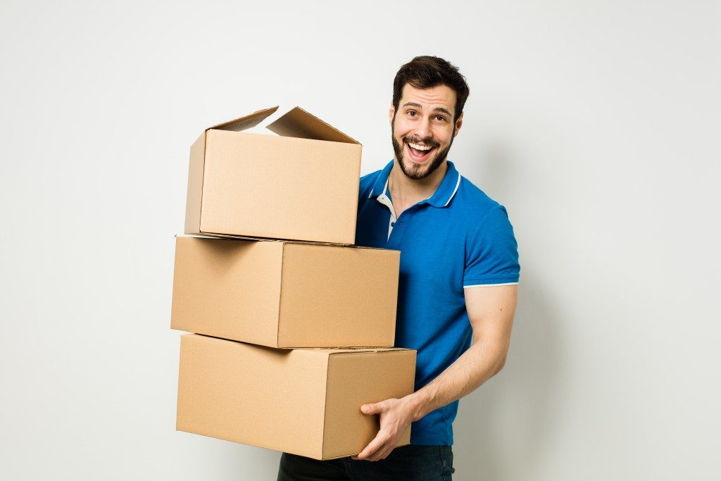 A man holding a pile of boxes