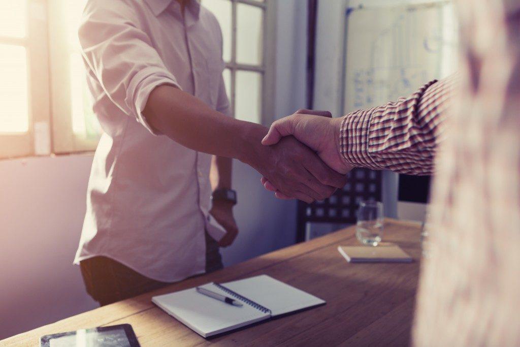 Entrepreneur handshake with a client