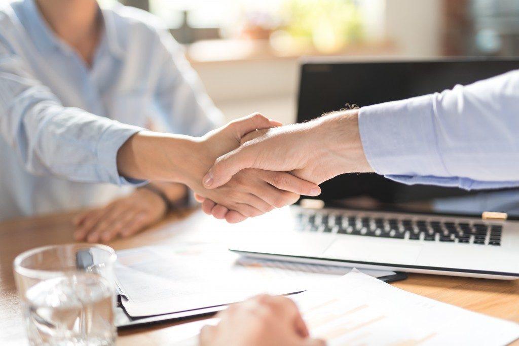Manager and employee handshake