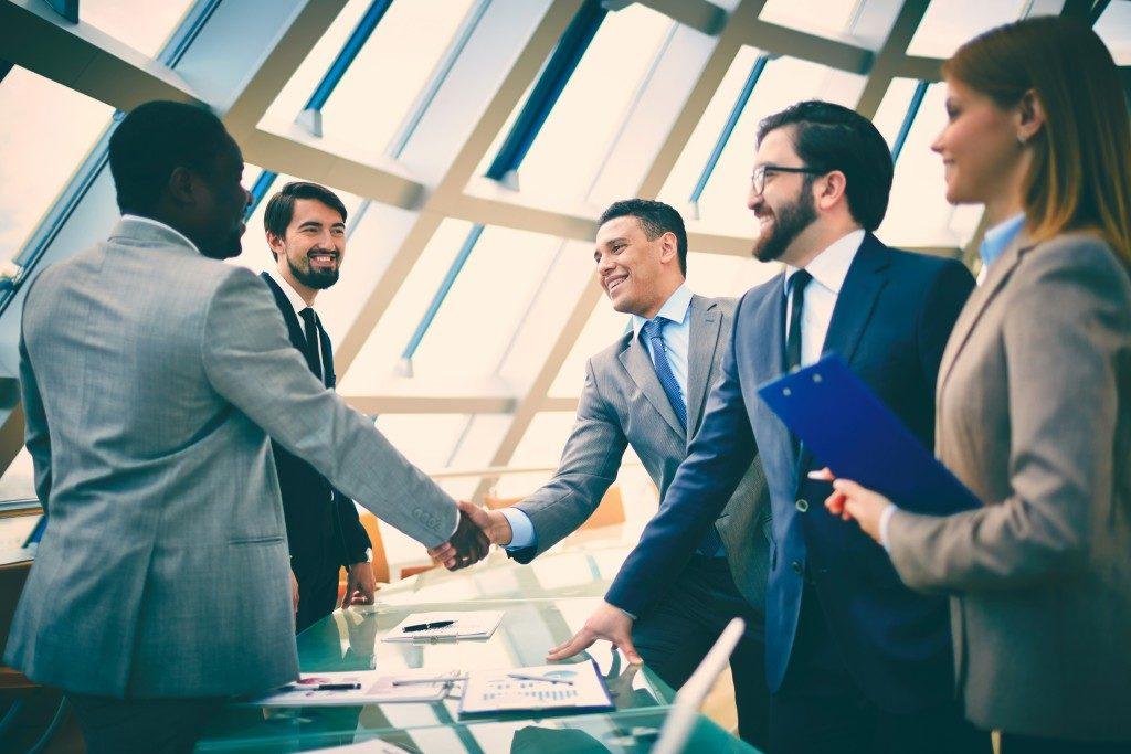 Business people handshake after meeting