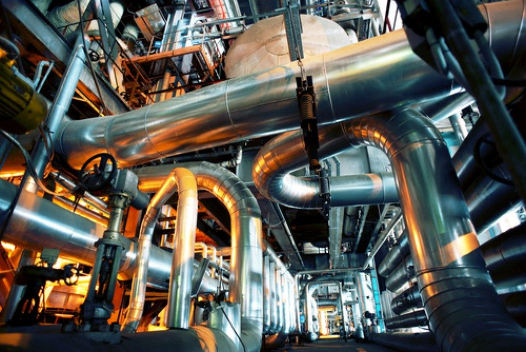 large tubes industrial equipments inside a factory