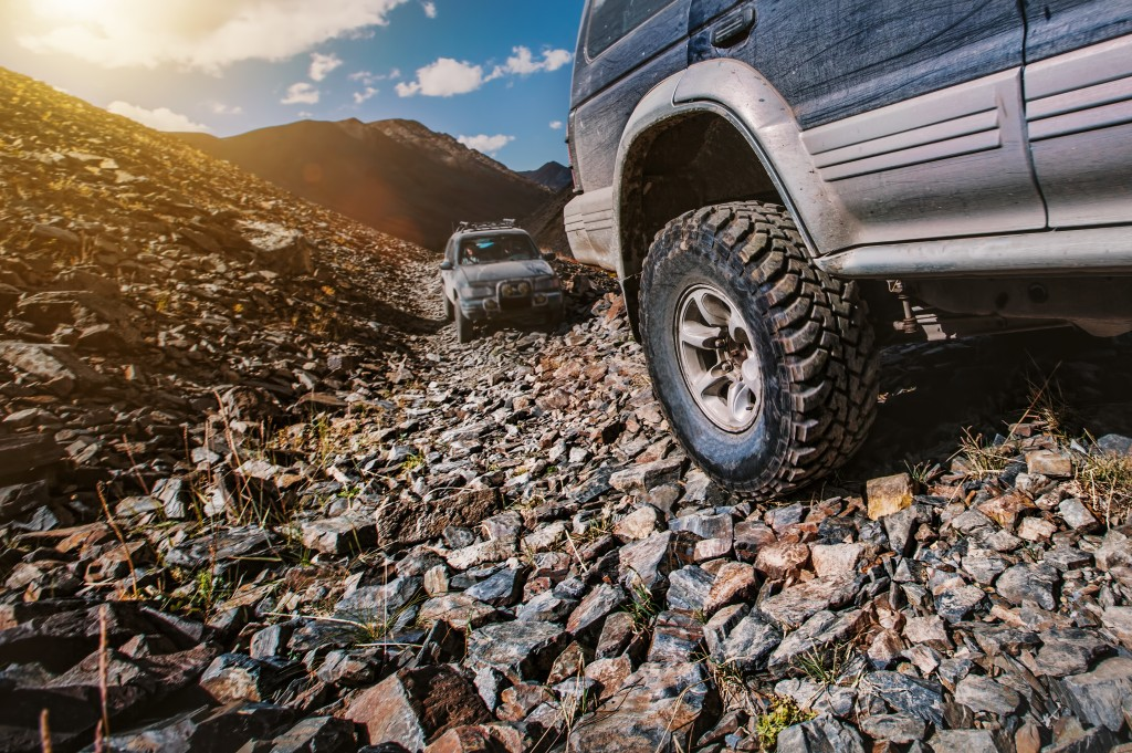 SUV on a rocky road