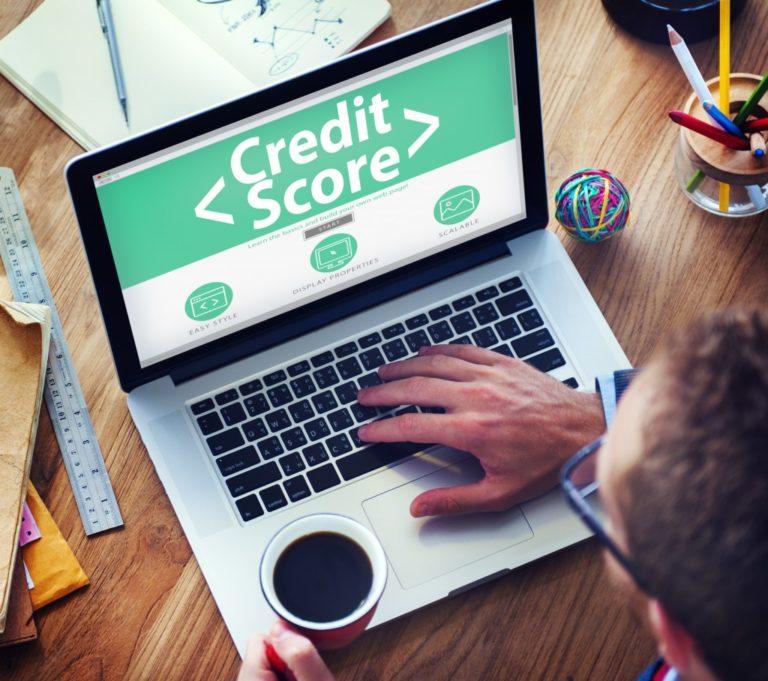 man checking his credit score online