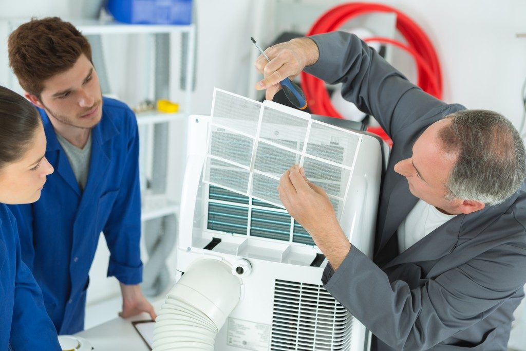 Technicians fixing the aircon