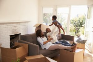 samll family moving into a new home