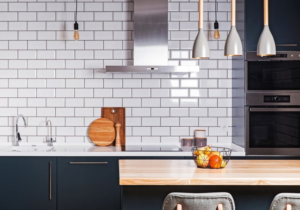 modern design kitchen with brick wall