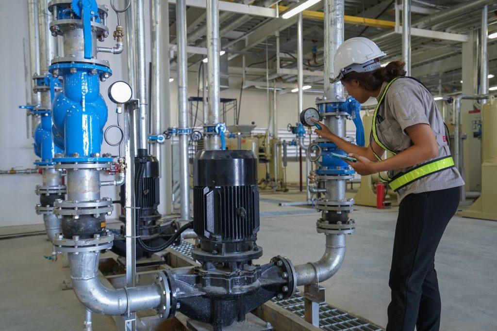 engineering inspecting the machine