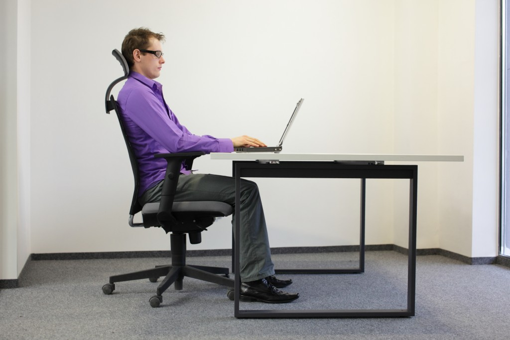 man using an ergonomic chair