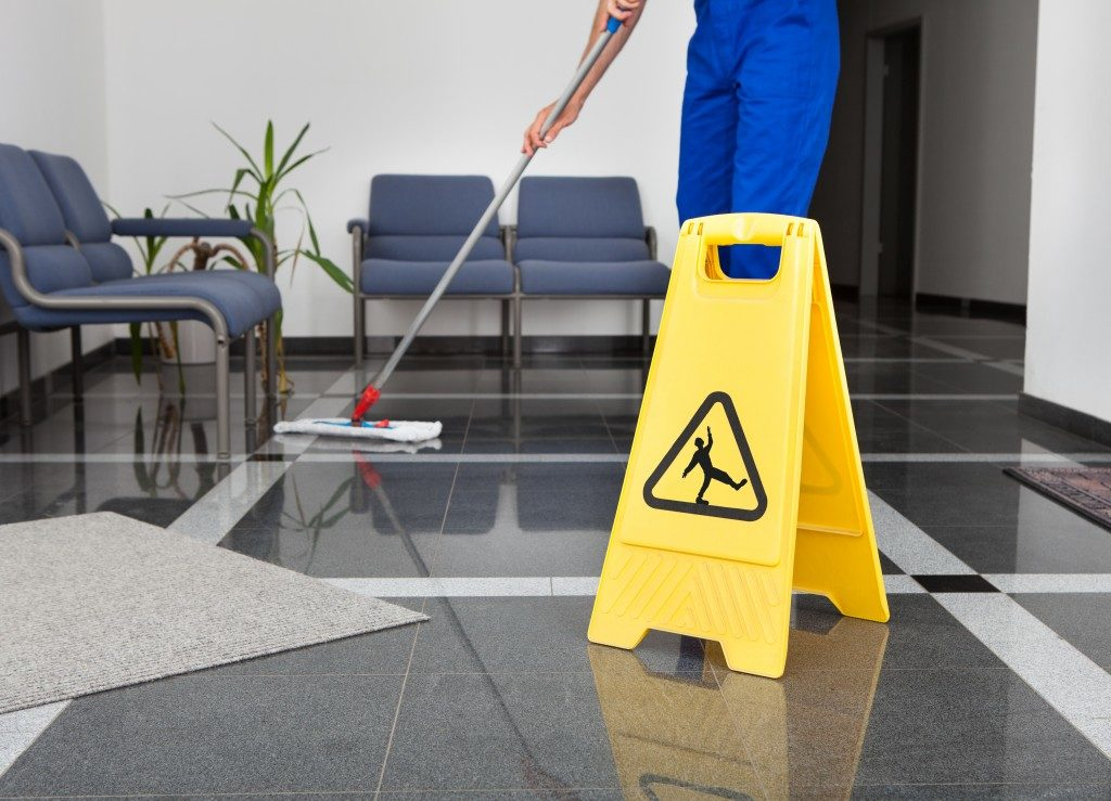 Employee mopping the floor