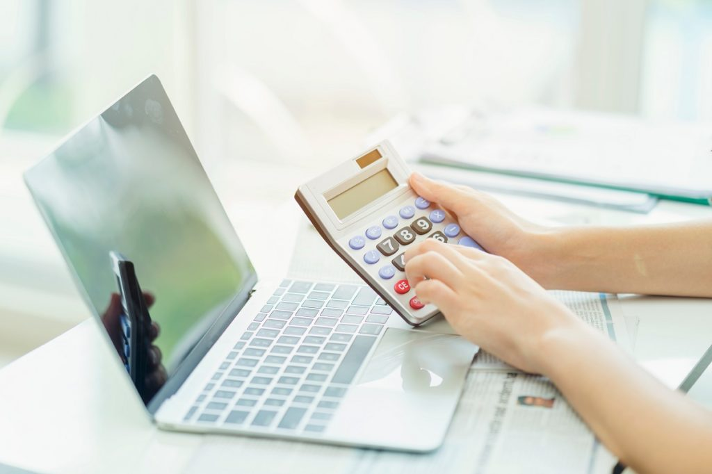 working with laptop and calculator