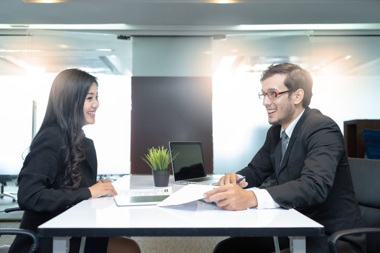 Human resource interviewing an applicant