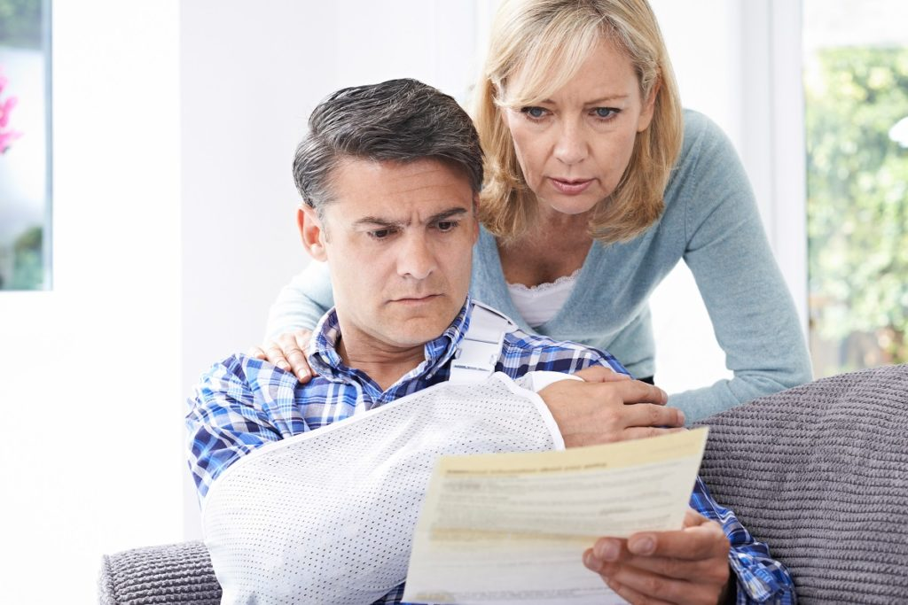 married couple reviewing a document on their personla injury claim