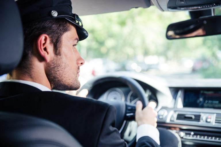 Portrait of chauffeur driving the car