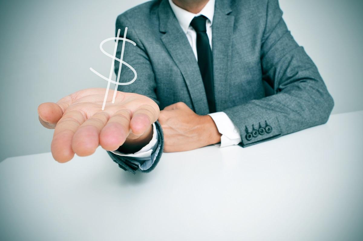 hand of businessman with dollar sign