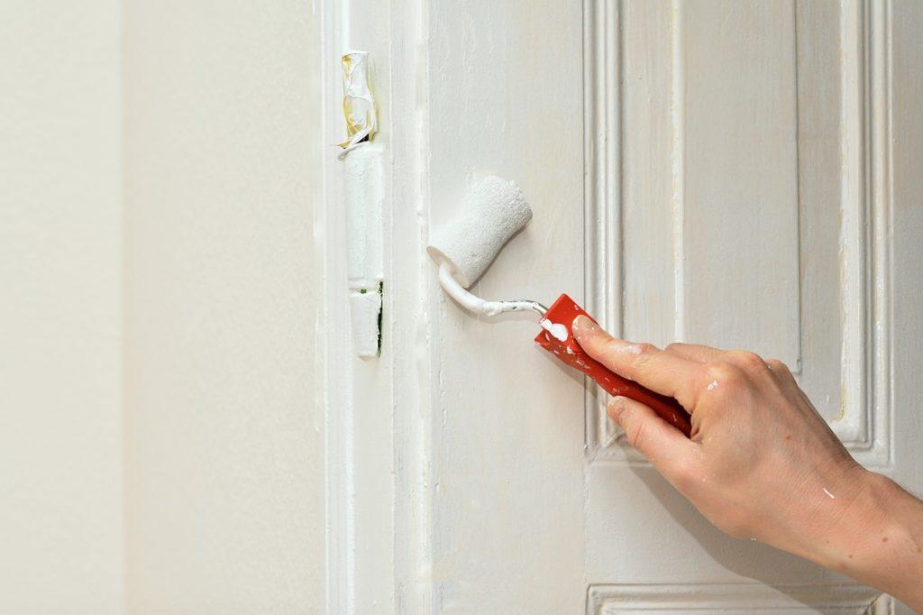 man painting doors