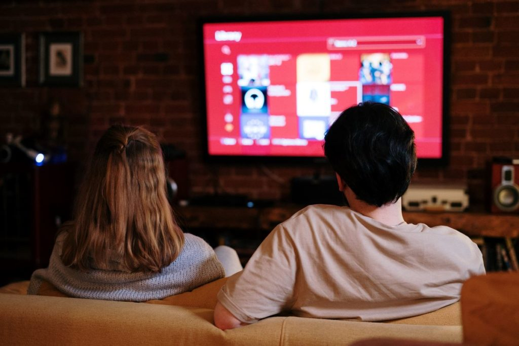 couple watching video on demand on tv