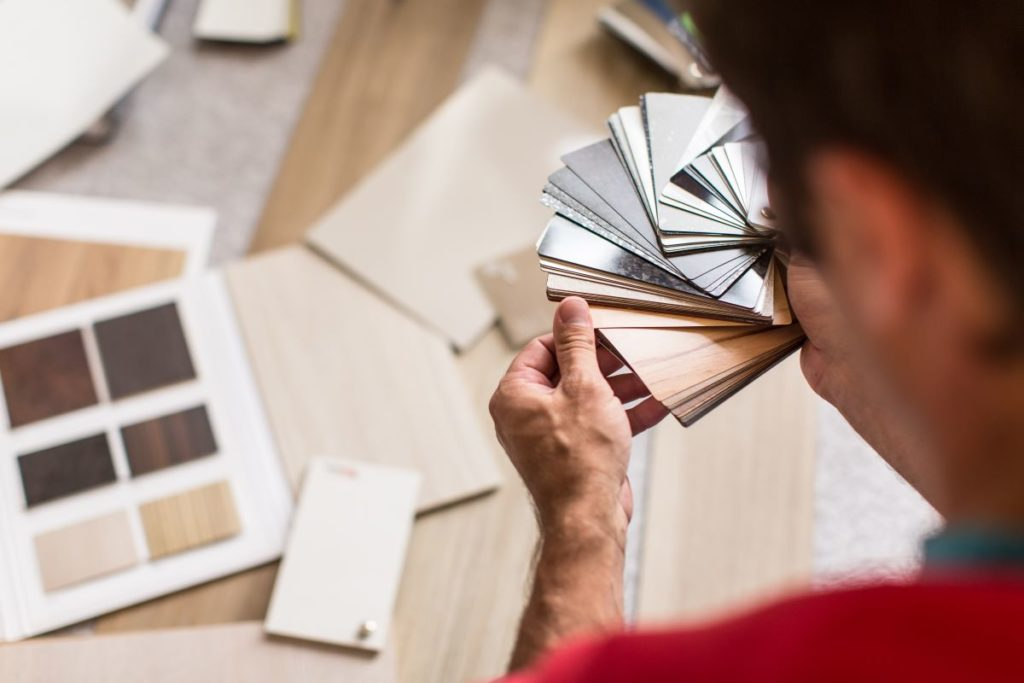 Man choosing the right flooring for his house