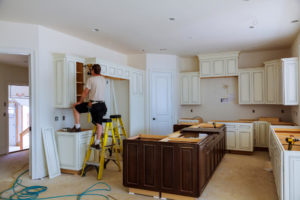 man working on kitchen