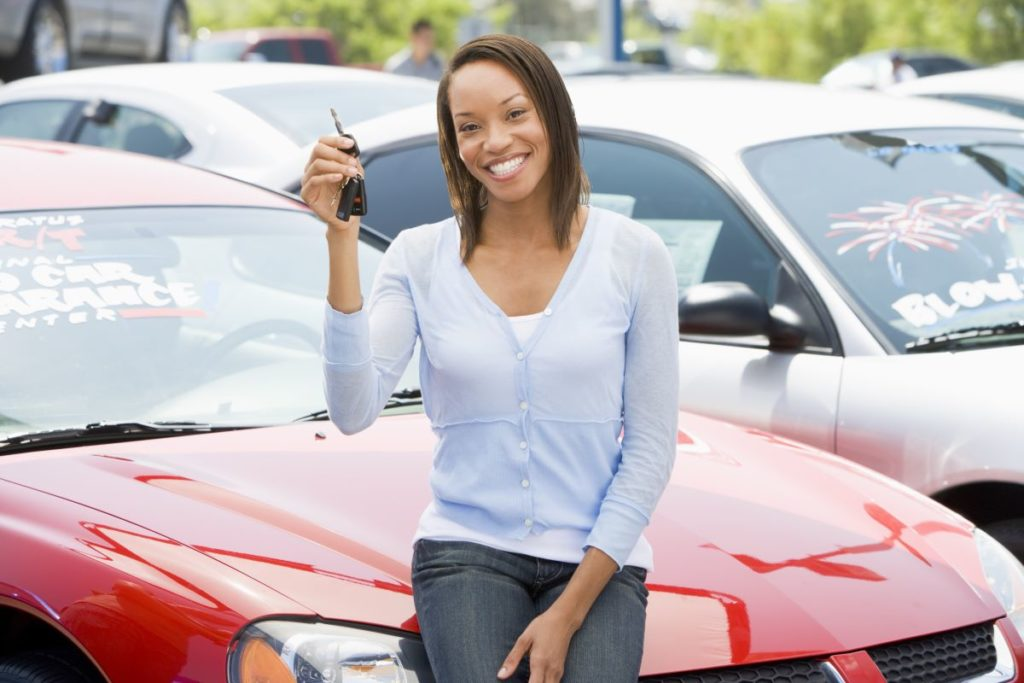 woman buying used car at a used car dealership
