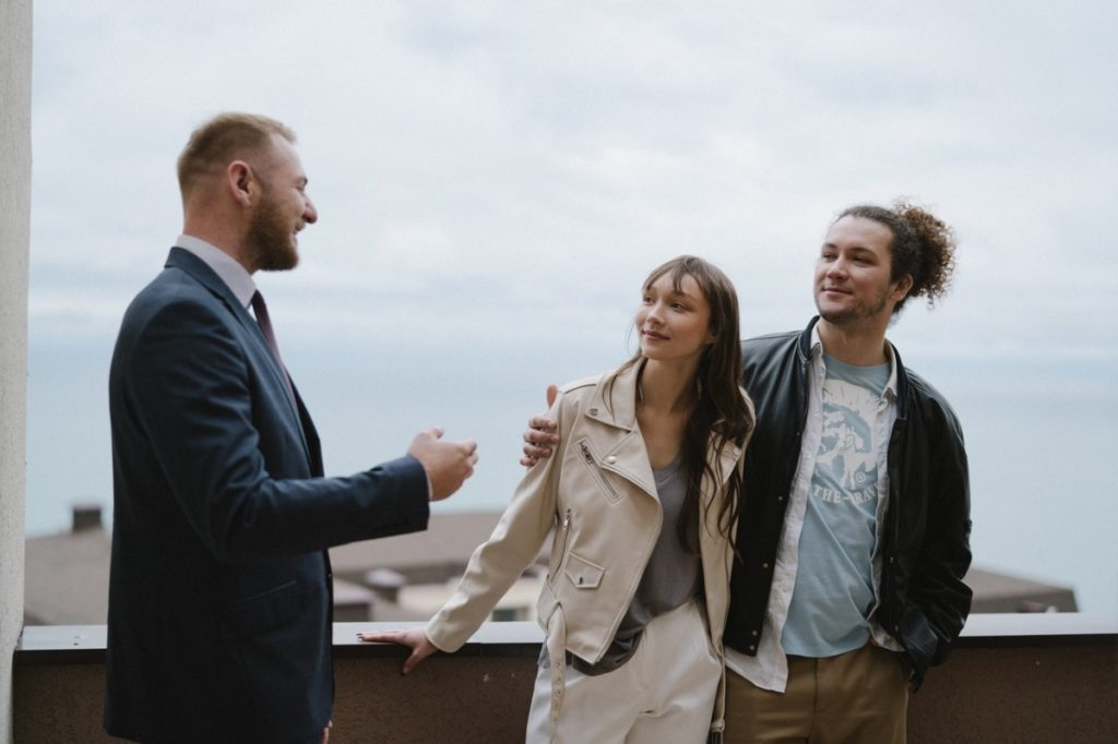 man talking to a couple