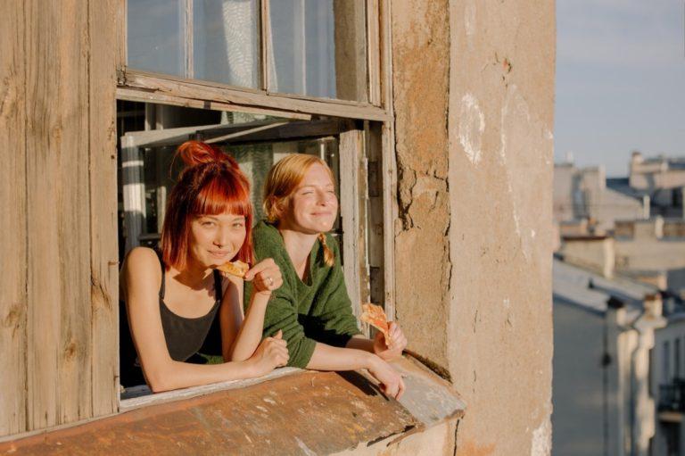 women looking out a window