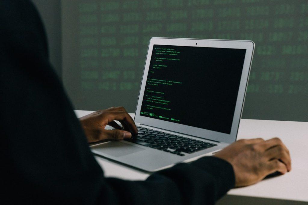 man writing codes