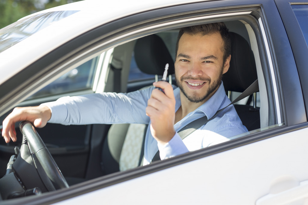 person with new car