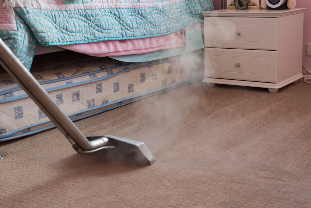 person disinfecting the carpet