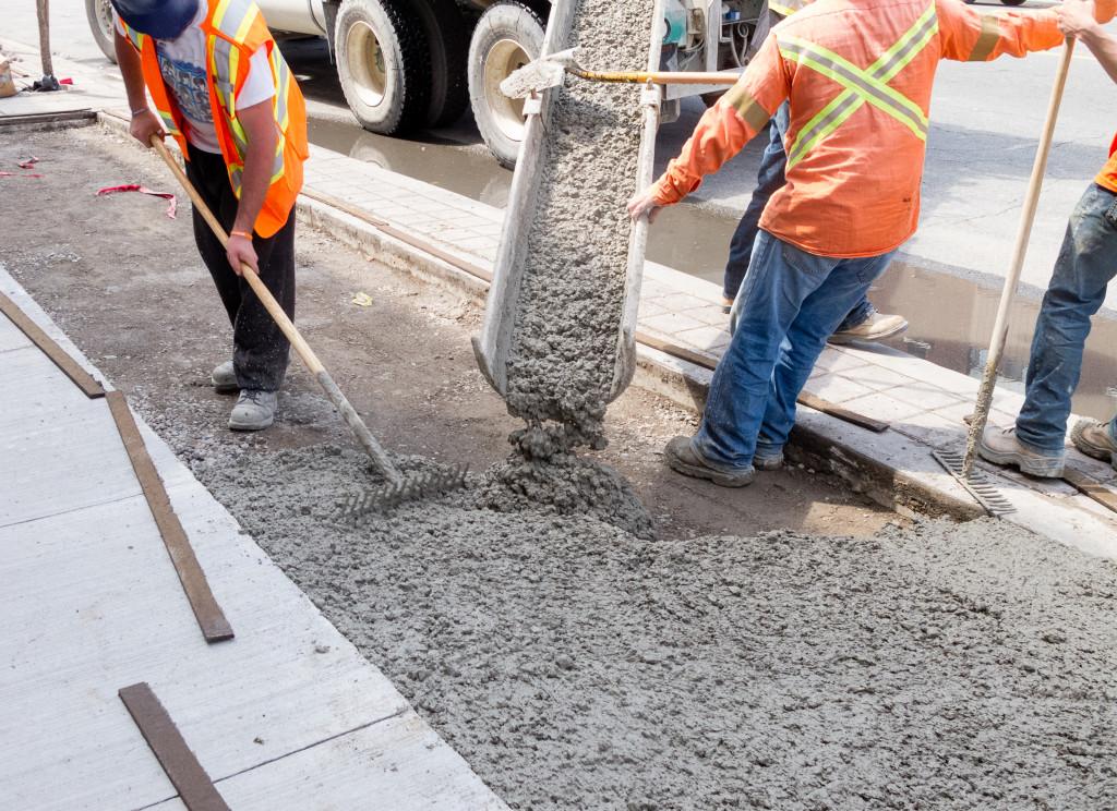 men pouring cement
