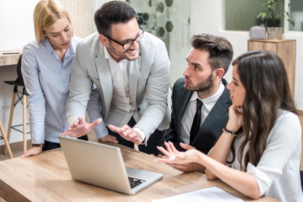 entrepreneurs using a laptop