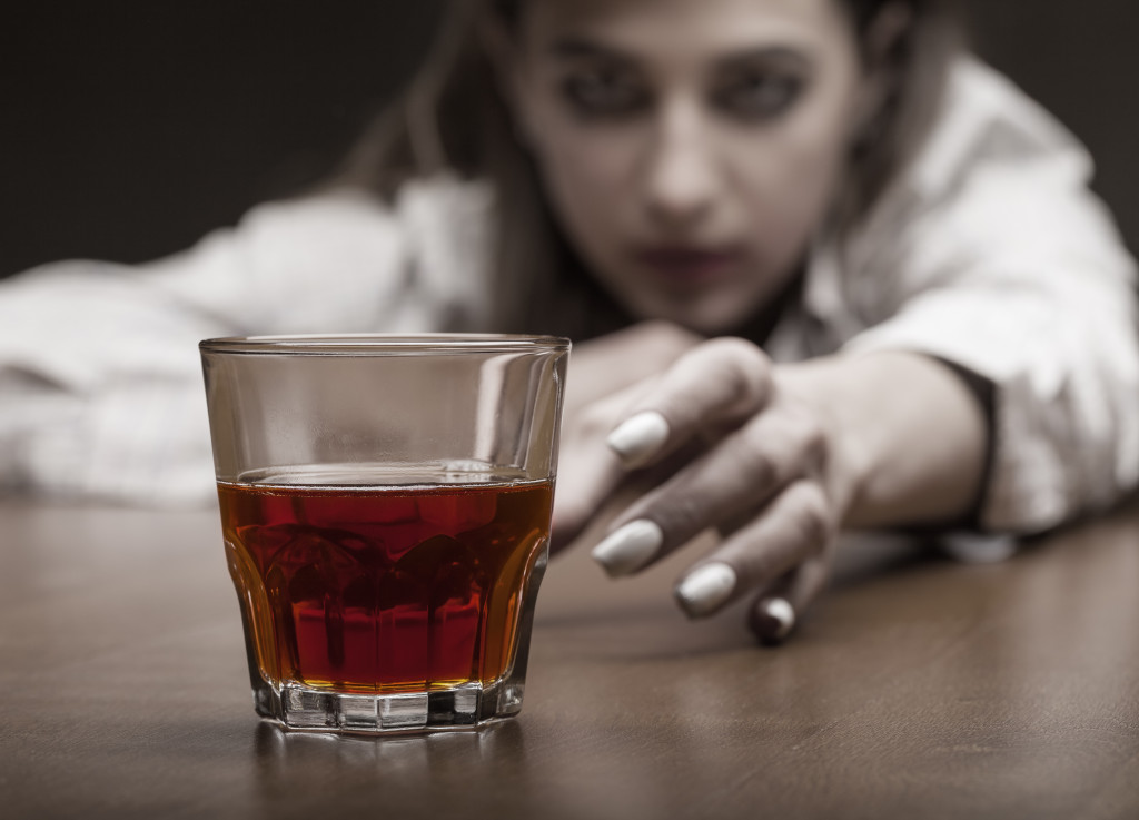 a woman and a glass of alcohol